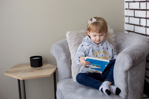 little-girl-in-her-reading-chair